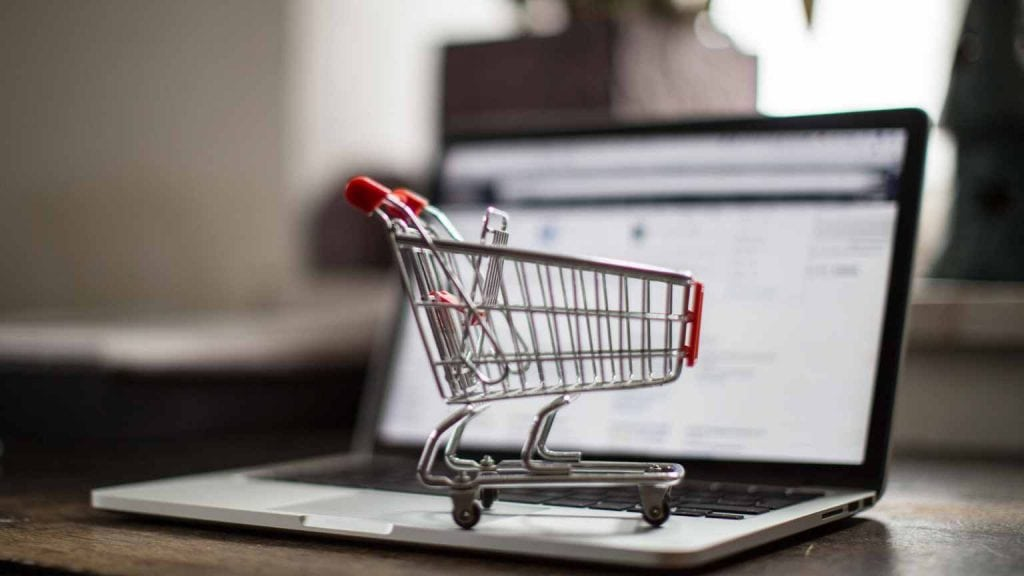 A Shopping Cart On a Laptop Showing E-Commerce Stores-Cedric Millar Canada Supply Chain Logistics Company
